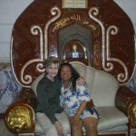 Terri Guevara Smith with Guam's Congresswoman, Bordallo, sitting on Suddam's Golden Chair in Al Faw Palace, Camp Victory Baghdad 2005