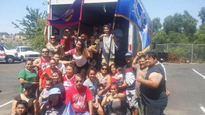 CNMI Club loading trucks of donated items for shipping